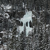 Snow covered trees with frozen waterfall, Lake Louise, Banff National Park, Alberta, Canada