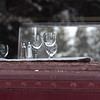 Empty wineglasses as seen through a window of the Canadian Pacific train, Banff National Park, Alberta, Canada
