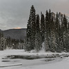 Stream flowing in snow covered valley in winter, Yoho National Park, British Columbia, Canada
