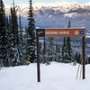 Kicking Horse direction sign with mountains in the background, Field, British Columbia, Canada
