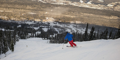 Tourist skiing in valley, British Columbia, Canada