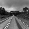 Empty road passing through rural landscape, St. Peter's, Cape Breton Island, Nova Scotia, Canada