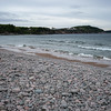 Scenic view of pebbles on beach, Cabot Trail, Cape Breton Island, Nova Scotia, Canada