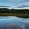 Scenic view of calm river in forest, Cheticamp, Cabot Trail, Cape Breton Island, Nova Scotia, Canada