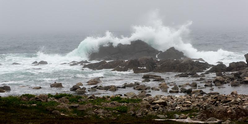 Water splashing on rocky coastline, Fortress of Louisbourg, Louisbourg, Cape Breton Island, Nova Scotia, Canada