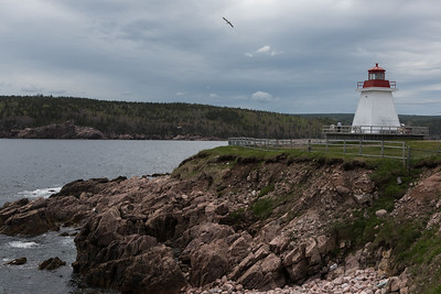 Lighthouse at coast, Neil's Harbour, Cape Breton Island, Nova Scotia, Canada