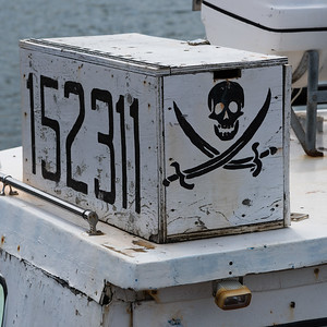 Skull symbol on fishing boat at harbor, Dingwall, Cape Breton Island, Nova Scotia, Canada