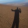 Shadow of person standing on the beach, Mabou, Cape Breton Island, Nova Scotia, Canada