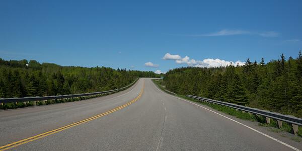 Empty road amidst trees in forest, Frankville, Cape Breton Island, Nova Scotia, Canada