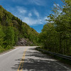 Empty road amidst trees by hills, Dingwall, Cabot Trail, Cape Breton Highlands National Park, Cape Breton Island, Nova Scotia, Canada