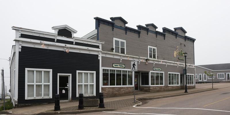 Buildings along street in town, Louisbourg, Cape Breton Island, Nova Scotia, Canada