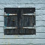 Closed Shutters on an bandoned building at Fort Petrie, New Victoria, Cape Breton Island, Nova Scotia, Canada