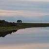 Scenic view of calm river with house in background, Cheticamp, Cabot Trail, Cape Breton Island, Nova Scotia, Canada