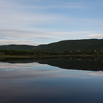 Scenic view of calm river with mountains in background, Cheticamp, Cabot Trail, Cape Breton Island, Nova Scotia, Canada
