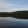 Scenic view of calm river with mountains in background, Cheticamp, Cabot Trail, Cape Breton Island, Nova Scotia, Canada