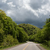 Empty road amidst trees in forest, Cabot Trail, Cape Breton Highlands National Park, Cape Breton Island, Nova Scotia, Canada