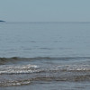 Boy with arms outstretched in the ocean, Inverness Beach, Mabou, Cape Breton Island, Nova Scotia, Canada
