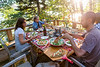 Family having meal on a deck, Lake of The Woods, Ontario, Canada