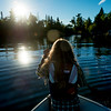 Girl on boat in a lake at morning sunlight, Lake of The Woods, Kenora, Lake of The Woods, Ontario, Canada
