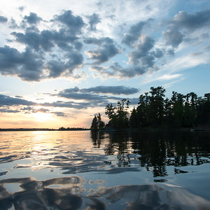 Reflection of tress and clouds on water, Lake of The Woods, Ontario, Canada