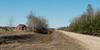 Dirt road passing through a field, Manitoba, Canada
