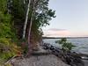 Trees and rocks along shoreline, Lake Winnipeg, Riverton, Hecla Grindstone Provincial Park, Manitoba, Canada