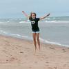 Girl having fun on the beach, York Point, Prince Edward Island, Canada