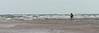 Girl walking on the beach, Prince Edward Island, Canada