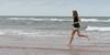 Girl running on the beach, Prince Edward Island, Canada
