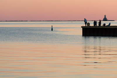 Tourists fly-fishing on pier at sunset, Spinnakers Landing, Summerside, Prince Edward Island, Canada