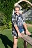 Girl playing on a seesaw, Green Gables, Prince Edward Island, Canada