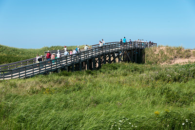 Tourists on wooden bridge at Cavendish Beach, Green Gables, Prince Edward Island, Canada
