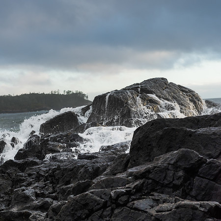 View of rocks at coastline, Pettinger Point, Cox Bay, Pacific Rim National Park Reserve, Tofino, British Columbia, Canada