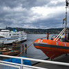 BC ferry and lifeboat at harbor, British Columbia, Canada