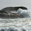 Wave splashing on rocky coast, Pacific Rim National Park Reserve, Tofino, Vancouver Island, British Columbia, Canada