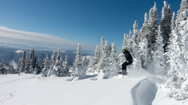 Tourist skiing in snow, Sun Peaks Resort, Sun Peaks, British Columbia, Canada