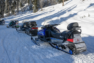 Snowmobiles along snow covered path, Sun Peaks Resort, Sun Peaks, British Columbia, Canada