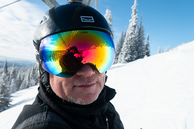 Close-up of a man wearing goggles and a helmet, Sun Peaks Resort, Sun Peaks, British Columbia, Canada