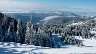 Scenic view of snow covered mountainside at ski resort, Sun Peaks Resort, Sun Peaks, British Columbia, Canada