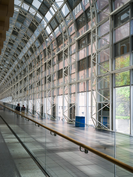 People walking up an interior atrium corridor Toronto, Ontario, Canada
