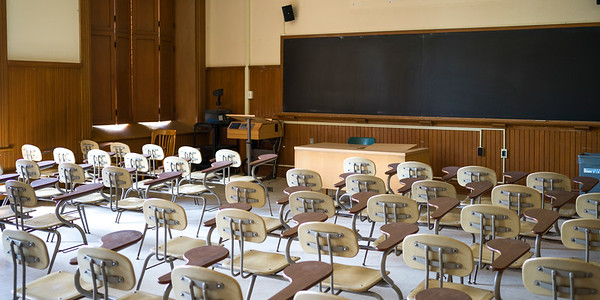 Desks and blackboard in empty lecture hall, University of Toronto, Toronto, Ontario, Canada