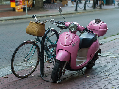 Moped and bicycle parked at roadside, Gastown, Vancouver, Lower Mainland, British Columbia, Canada