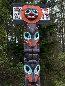 Low angle view of totem pole, Stanley Park, Vancouver, Lower Mainland, British Columbia, Canada