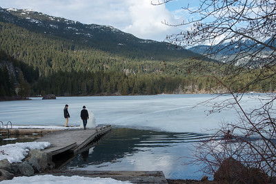 Tourists standing on a dock at the lakeside, Whistler, British Columbia, Canada
