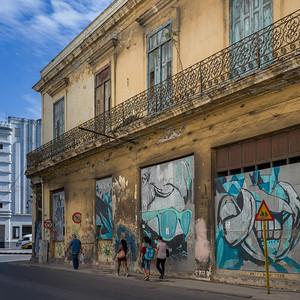 People walking on the sidewalk, Havana, Cuba
