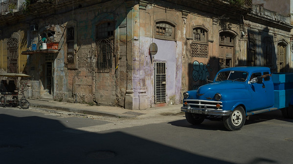 Vintage truck parked on the road in front of a house, Havana, Cuba