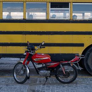 Motorbike parked near a bus, Havana, Cuba