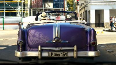 Rear view of a person driving a vintage convertible, Havana, Cuba