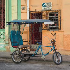 Rickshaw parked outside a building, Havana, Cuba