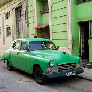 Vintage car parked on the road in front of a house, Havana, Cuba